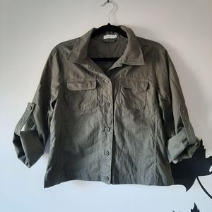 Army green roll-up button down collared shirt.